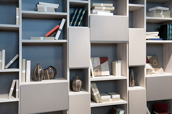 modern library cabinet with books and ornaments displayed on open shelves