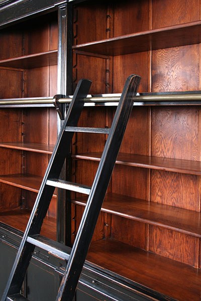 vintage library bookshelves and ladder